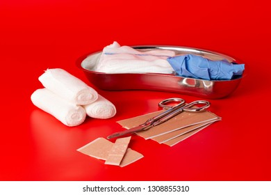 Plasters and bandages with Scissors and syringe on a white background