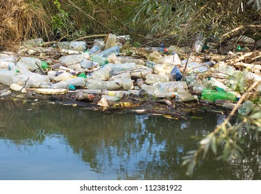Plastic and aluminum garbage in water