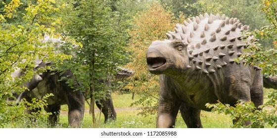 Plastic ankylosaurus manikin in nature.