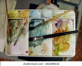 plastic artist's palette for working with watercolors and brushes.