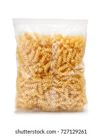 Plastic bag of fusilli pasta isolated on white