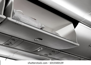 Plastic bag luggage in cabin or compartment on airplane for travel conceptual background.