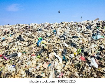 Plastic bag rubbish from industrial and factory trash in the landfill made the air pollution in environment.