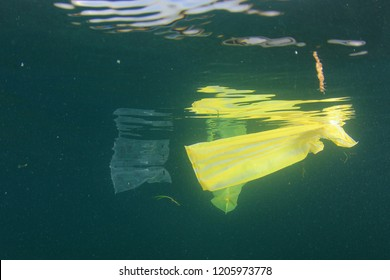 Plastic bags, bottles and straws pollution in ocean