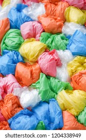 Plastic bags. A closed up details of colorful plstic bags in pile, plastic bags pattern and texture for background.