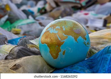 Plastic bags planet earth. Worldwide garbage collection. Let's do it! Clear the planet of plastic debris.