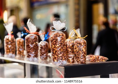 Plastic bags of roasted nuts are for sale on a street vendors stall in the city of Melbourne, Australia