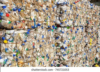 Plastic bales bottles at the waste processing plant. Separate garbage collection. Recycling and storage of waste for further disposal. Business for sorting and processing of waste.