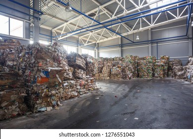 Plastic bales of rubbish at the waste treatment processing plant. Recycling separatee and storage of garbage for further disposal, trash sorting. Business for sorting and processing of waste.