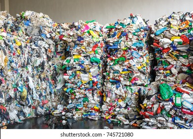 Plastic bales at the waste processing plant. Separate garbage collection. Recycling and storage of waste for further disposal, trash sorting. Business for sorting and processing of waste.