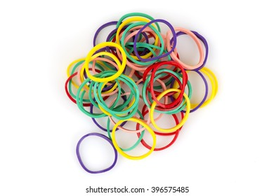 Plastic band of many colors on white background.