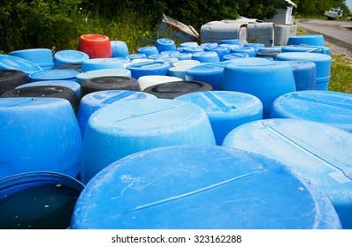 Plastic barrels abandoned by the road, Nova Scotia, Canada