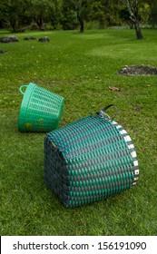 plastic basket on a green garden grass
