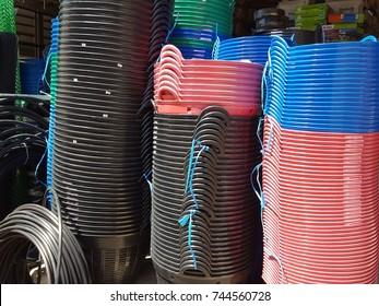 Plastic basket  for plant a tree, Plastic basket shop, garden arrangement, Colored plastic containers, Colorful of plastic basket box in factory, Storage logistic business.
