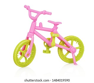 Plastic bicycle toy. With clipping path. Isolated on white background with shadow reflection. With vector path.