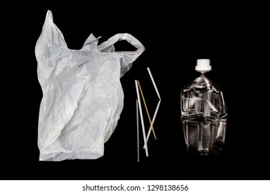 Plastic bottle, plastic bag and drinking straws with black background