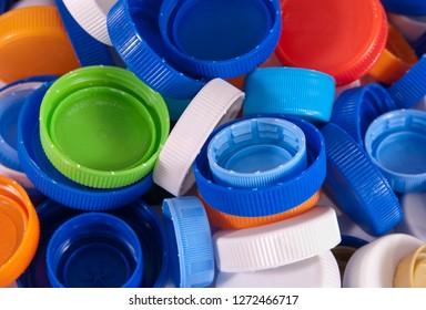 Plastic bottle caps as a background. Close up image