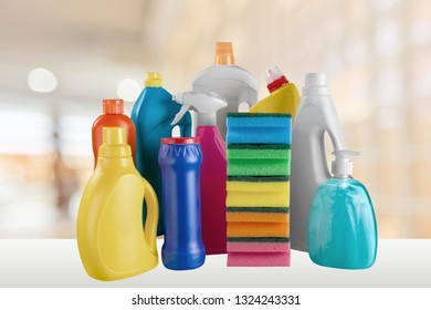 Plastic bottle, cleaning  gloves and bucket