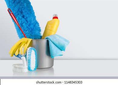 Plastic bottle, cleaning sponge and gloves