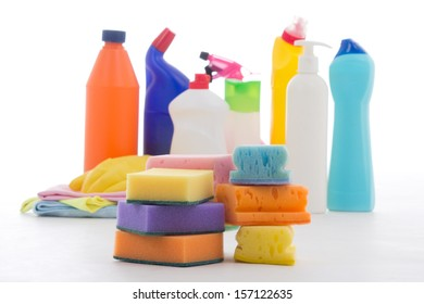 plastic bottle, cleaning sponges and gloves isolated on white background
