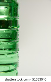 A plastic bottle filled with still water. Image isolated on white studio background.