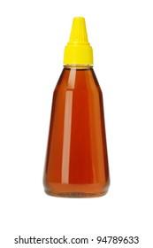 Plastic Bottle of Honey on White Background