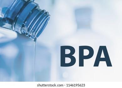Plastic bottle and liquid stream. Bisphenol, BPA FREE plastic photo