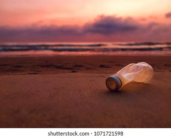 Plastic bottle on a Beach pollution concept.