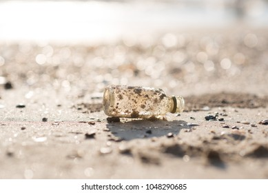 plastic bottle on the beach at the seaside