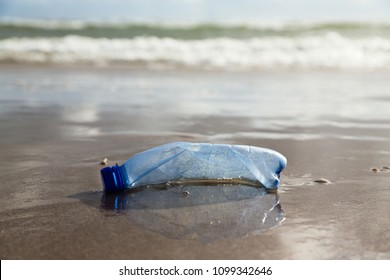 plastic bottle on the shore
