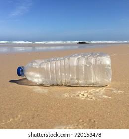 Plastic bottle rubbish polluting the beach