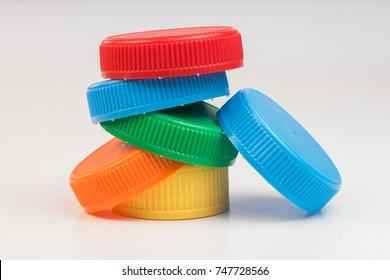 Plastic bottle screw caps isolated on white background