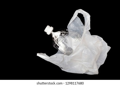 Plastic bottle with plastic shopping bag on black background