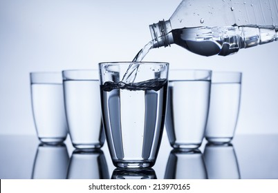 plastic bottle that fill up with water group of glasses on white background