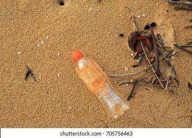 Plastic bottle washed up on dirty looking beach