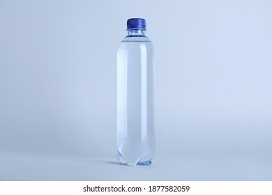 Plastic bottle with water on white background