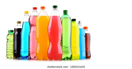 Plastic bottles of assorted carbonated soft drinks over white background