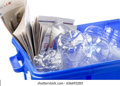 Plastic bottles in blue recycle bin