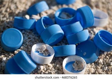 Plastic bottles cap on beach sand