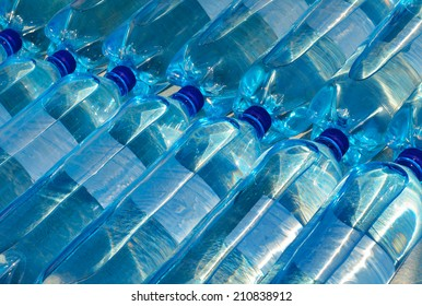 Plastic bottles with carbonated mineral water. Soda Bottles.