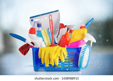 Plastic bottles, cleaning sponge and gloves  on background