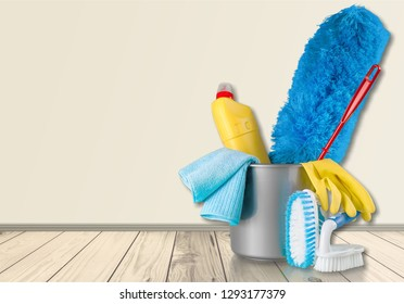 Plastic bottles, cleaning sponges and gloves  on background