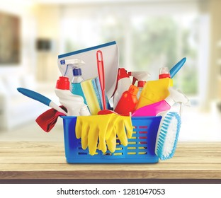 Plastic bottles and cleaning sponges on white background