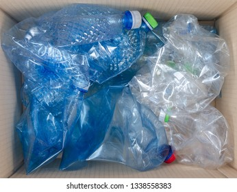Plastic bottles discarded in the trash can  for recycling. Selective recycling concept .