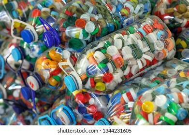 Plastic Bottles Filled With Bottle Caps At The Recycling Plant. Disposal Concept. Kyiv, Ukraine, Kyivmyskvtorresursy Plant. Kyiv Plant for recycling. 01.10.2018