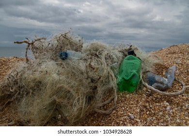 Plastic bottles and fishing nets pollute the shore. poor culture of consumption to achieve the progress of modern civilization gives a negative impact on the surrounding nature. Ecological catastrophe