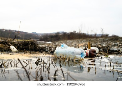 Plastic Bottles Floating in the river. River Pollution, PVC waste