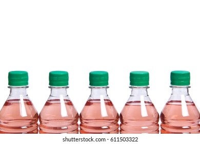 Plastic bottles with green lids on a white background