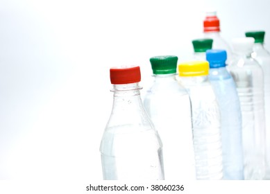 Plastic bottles of mineral water isolated on  the  white background