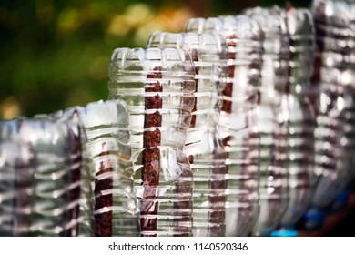 Plastic bottles on a fence